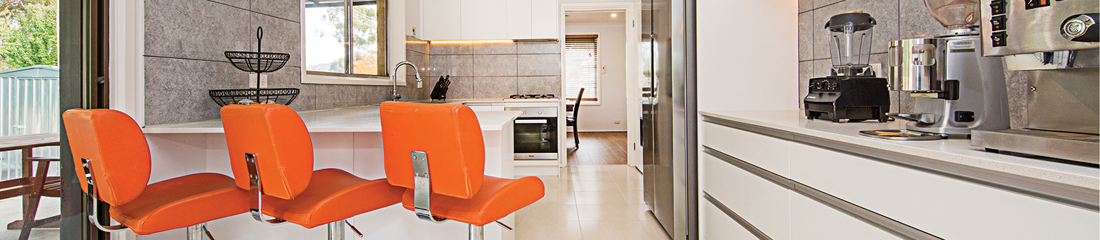 Modular kitchen with a breakfast counter.