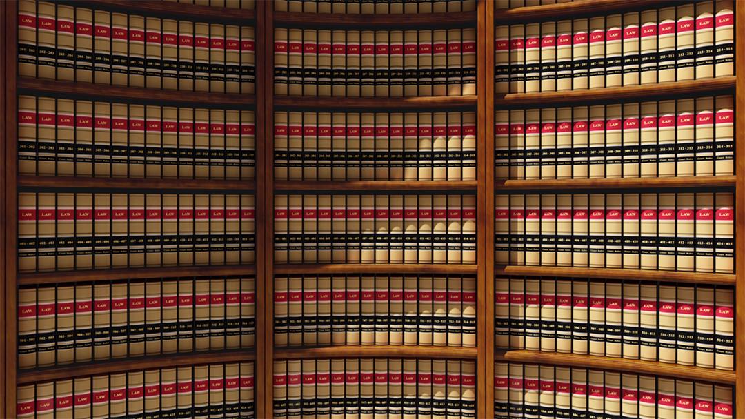 Law books in wooden shelf.