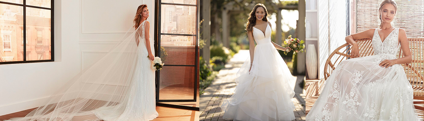 Gorgeous brides in three different bridal gowns with flowers bouquets in hands posing for photo.